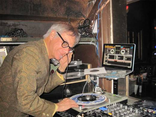 Phast Phreddie the Boogaloo Omnibus deftly uses the laptop to hold his record sleeves as he DJs at Bubble & Squeak.