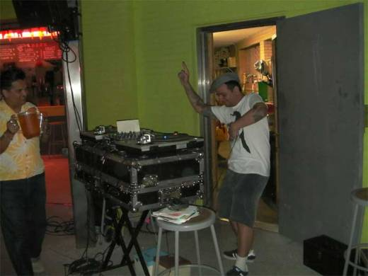 Our pal Tony brings DJ Ratta a beer for his birthday at Shake It Up Sunday!