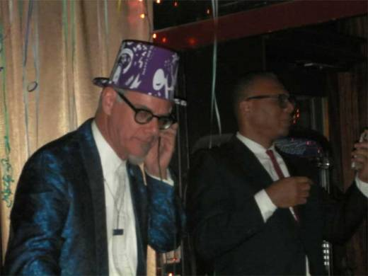 "Phast Phreddie the Boogaloo Omnibus cues ""Auld Lang Syne"" as Gaylord Fields keeps an eye on the time at the DYNAGROOVE NEW YEAR'S EVE SPECTACULAR!"