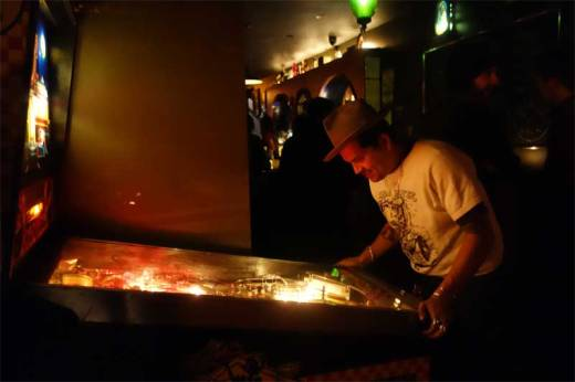 Between his DJ sets, Tony Salvaje scored a replay on Bootleg Bar's groovy pinball machine at WHAM-O WATUSI!