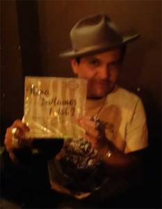Tony Salvaje shows off one of the fine records he played at WHAM-O WATUSI!