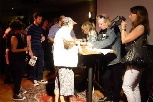Gillian McCain and Legs McNeil sign autographs at the Please Kill Me - 20th Anniversary Tour event.